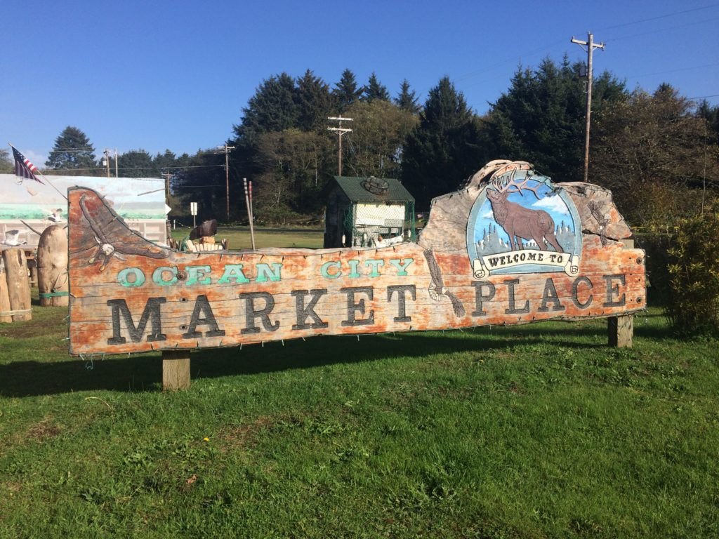 ocean sity marketplace carved sign by judy mcvay