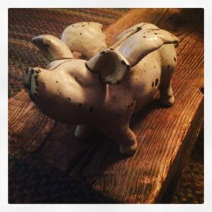 old cast iron flying pig bank